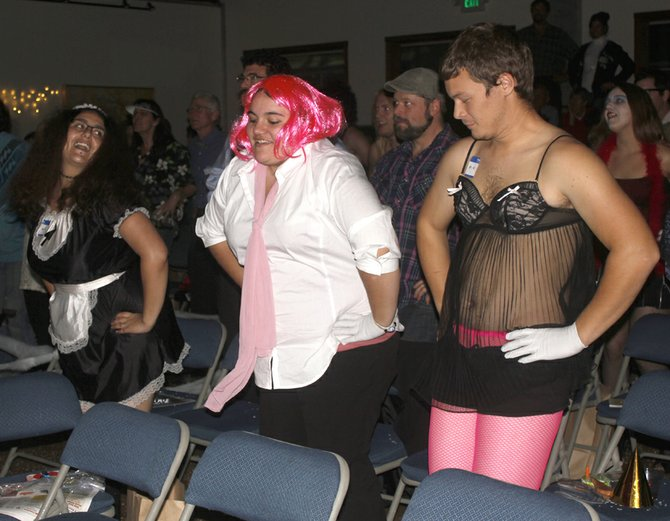 """""""The Rocky Horror Picture Show"""" fans do the """"Time Warp"""" as the dance plays Friday night on the big screen in the CommunityCultural Center in Tonasket."""