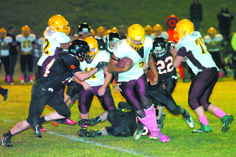Alex Rivera, left, sets his sights on Inchelium-Columbia's Thomas Cohen during Oct. 25 game.