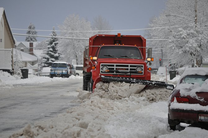 A City of Grangeville snowplow clears the streets after a winter storm in 2010.