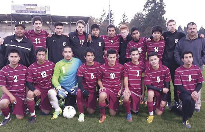 MEMBERS of The Dalles Wahtonka soccer team pose for a group shot moments before the start of their match at  in Hood River. Eight members, led by first-teamers Sergio Rios and Aldo Rivas, were named to the Columbia River Conference all-league team. Luis Gamez was also named as Coach of the Year.              Contributed photo
