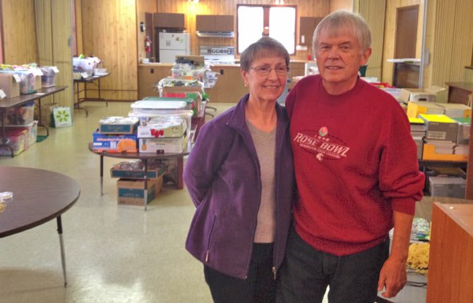 JEAN AND DON HENDRICKSON take a pause from a box packing session at their church in Bingen.      	Contributed photo