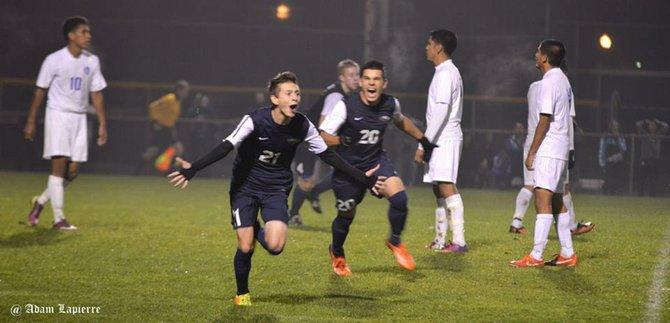 The Eagles celebrate one of their three goals against Woodburn.