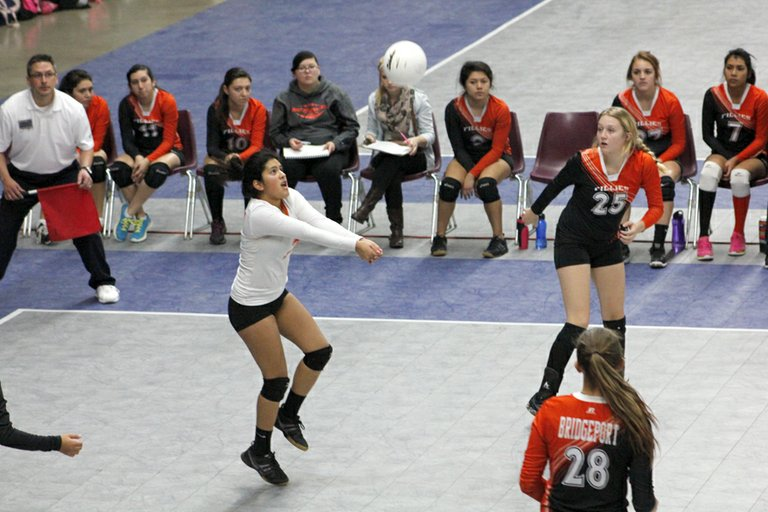Bridgeport senior Diocelina Torres returns a serve against Toutle Lake High School during the Fillies' state volleyball tournament opener Friday morning in Yakima.