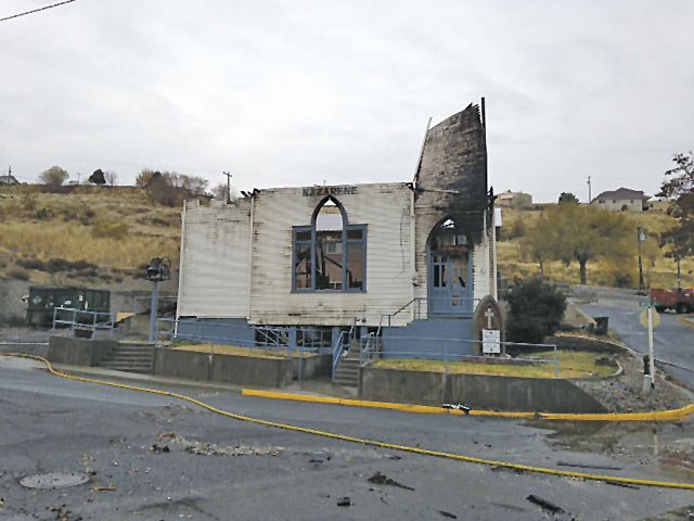 This photo taken in Arlington, Ore., Tuesday, Nov. 12, 2013, and supplied by the Gilliam County Sheriff's office, shows the Church of the Nazarene that was gutted by fire the same morning.  The sheriff's office says investigators have concluded the fire that destroyed the historic church was caused by arson, and a $5,000 reward is being offered for information.