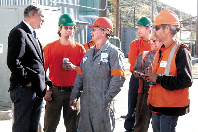 Gov. Jay Inslee talks with Omak Wood Products workers Monday during the mill's reopening ceremony. More than 100 employees and community leaders attended.