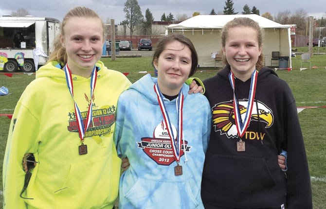 THE DALLES WAHTONKA runners (pictured from left), Avery Cardosi, Emily Morin and Katie Burns proudly display medals won at this past weekend's Junior Olympic Meet at Western Oregon University in Monmouth.