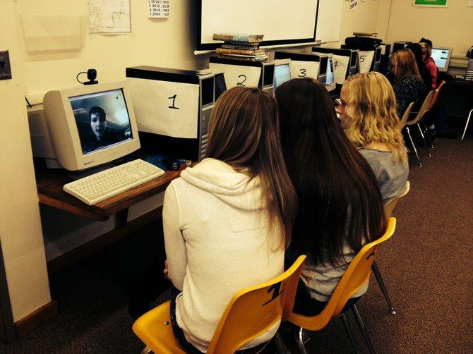 Alyssa Koberstein, Kate Lutz and Marie Hauger Skype with their career mentor during Mrs. Bernadette Edwards' eighth-grade technology class.