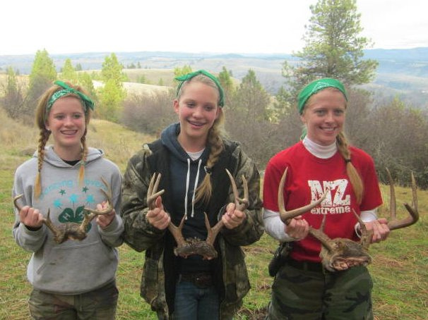 Maria Behler, 14, and Laren Dillard, 15, both of Lewisotn and Amy Rose of Greencreek pose with their trophy antlers at girls' hunting camp.