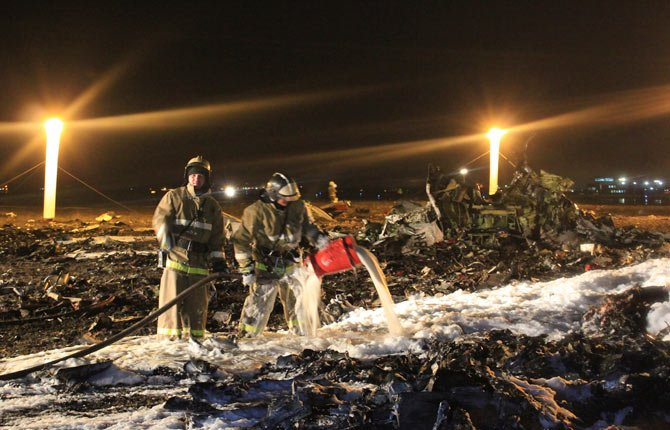 IN THIS photo provided by Russian Emergency Situations Ministry, fire fighters and rescuers work Nov. 17 at the crash site of a Russian passenger airliner near Kazan, the capital of the Tatarstan republic, about 720 kilometers (450 miles) east of Moscow. A Russian passenger airliner crashed Sunday night while trying to land at the airport in the city of Kazan, killing all people aboard, officials said. The Boeing 737 belonging to Tatarstan Airlines crashed an hour after taking off from Moscow. There were no immediate indications of the cause.