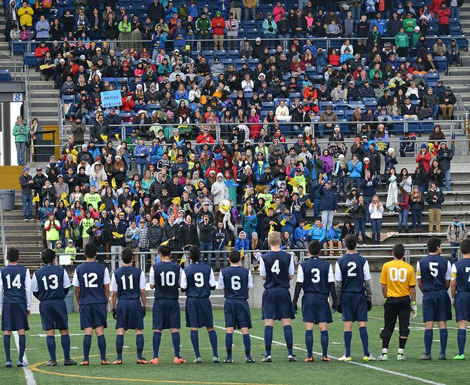 State finals action brought the Hood River Valley Eagles and the Summit Storm to Hillsboro Stadium Saturday morning to battle for the 2013 OSAA 5A title. Summit scored two first-half goals and held off the Eagles offense to take the win. The large crowd of Hood River supporters cheering for the team during pre-game introductions.