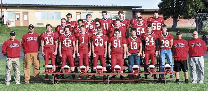 MEMBERS of the Dufur Ranger football team stand together for a photo in a group setting at Dufur High School. Seven players were named to the all-Big Sky Conference team. Senior quarterback Cole Parke picked up Player of the Year honors for the second consecutive year, and Jack Henderson tallied Coach of the Year status in leading his team to its second straight league crown.       Contributed photo