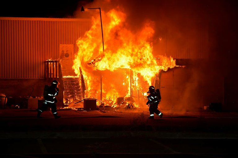 Flames engulf the Omak Elks Lodge building early Wednesday morning.