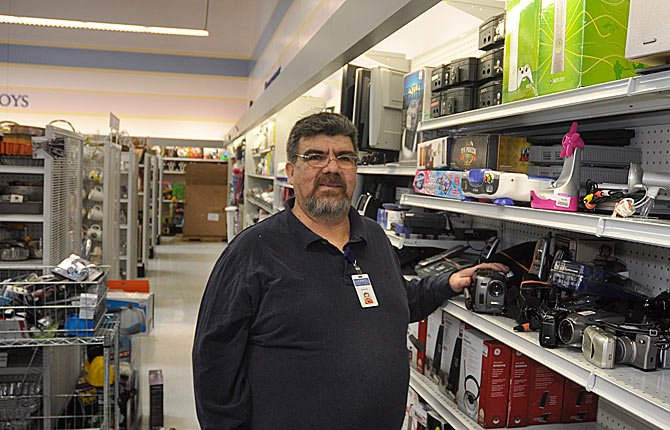 Andres Fuentes went to work for The Dalles' Goodwill store after being laid off from his job making parts for Air Force spy drones.