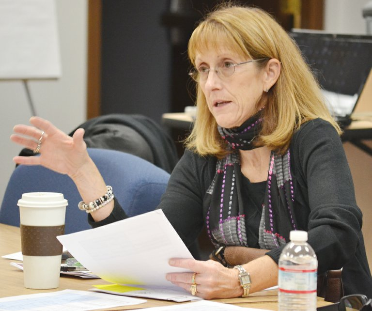 Sunnyside United coordinator Cathy Kelley outlines the 2013-14 budget for board members yesterday.