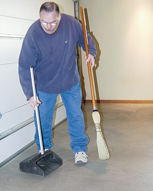 Dan Phillips does the maintenance work at Smith Funeral Home, including keeping the vehicles clean and running, making sure the landscaping is pretty and cleaning the halls and chapel.