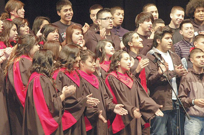 The Sunnyside High School choir, under the direction of Bruce Walker, performed a wide variety of classic and contemporary music during last night's end of trimester concert. As part of the concert, Walker had his tenors, bass, alto and soprano singers sing popular songs by such singers as Miley Cyrus and Bruno Mars.