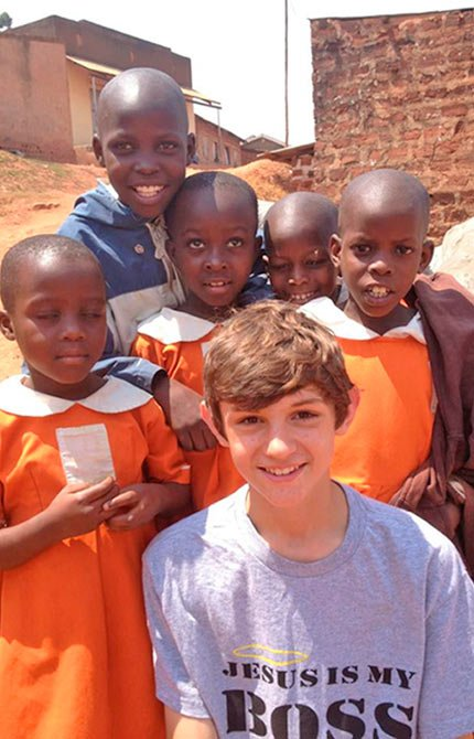 ZAC PALMER, A 15-YEAR-OLD from The Dalles, works with Ugandan children on a mission last summer through Global Expeditions.   	Contributed photo