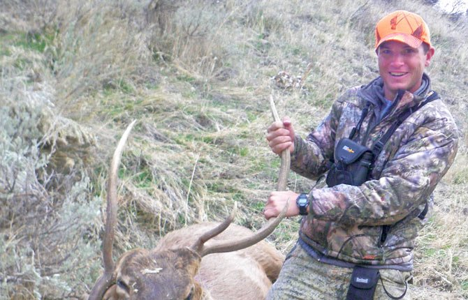 NATHAN MORRIS proudly displays his prized elk on a recent family trip in the back trails of Oregon. Morris gave detail in this column on what it took to finally bag an impressive animal while dealing with the elements.