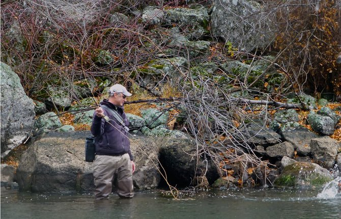 John Wolter fights a trout hooked in the South Fork of the Boise River in Mountain Home, Idaho.