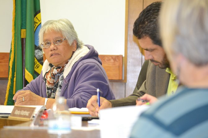 Mabton Councilwoman Oping Hutson participates in budget discussions during a special meeting last Friday to review budget figures for next year.