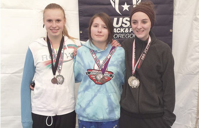 THE DALLES runners (pictured from left to right), Avery Cardosi, Emily Morin and Maddie Wood display their medals after competing in the Junior Olympic Regional Meet this past weekend at Western Oregon University in Monmouth.
