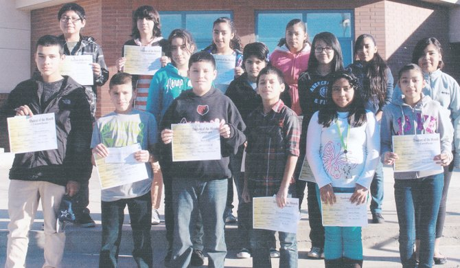 Sunnyside's Harrison Middle School students of the month for November are (front row L-R) Steven Rodriguez, Fabian Ortega, Ben Rios, Giancarlo Valencia, Berenice Ocampo and Olivia Dominguez; (middle row L-R) Yaridsa Cuevas, Susana Rodriguez, Briteny Zhu and Maraya Magana; (back row L-R) Jose Ahumada, Margarita Romero, Jaslyn Sern-Negrete, Fidela Santiago and Adriana Jimenez.