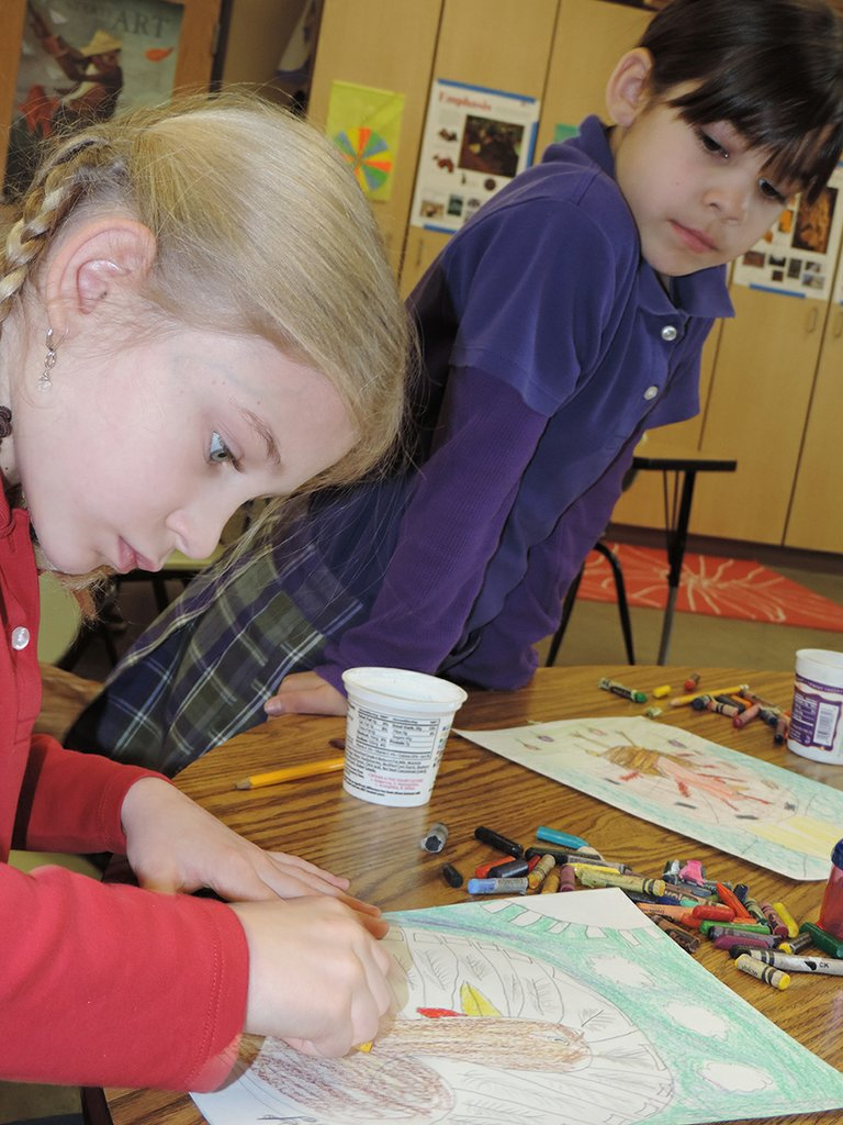 SAVANNAH MORING, right, admires classmate Julia Bounds' turkey drawing during class at Horizon Christian School.