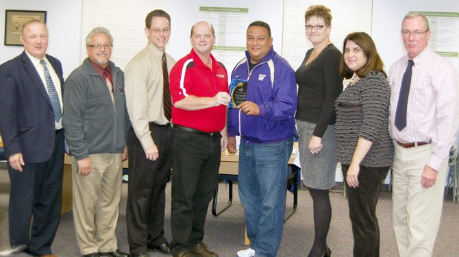 The Sunnyside School Board was recognized as the School Board of the Year for districts with enrollments of 9,000 students or less, by the Washington State School Directors Association last Saturday. Shown here with the award are (L-R) Sunnyside Schools Superintendent Dr. Rick Cole, former school director Lorenzo Garza Jr., current directors Dylan Gardner and Rocky Simmons, former director Miguel Puente and current directors Michelle Perry, Sandra Linde and Steve Winfree.