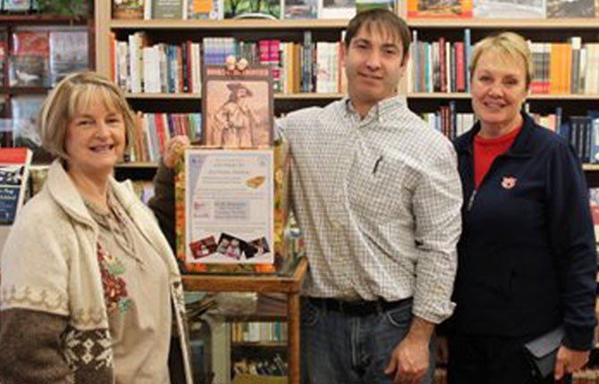 Connie Christensen, CRB board member, left, Jaoquin Perez, owner of Klindt's Booksellers and Stationers, center, and Sandra Fritz, CRB board member promote the 200 books for 200 children book collection under way through Dec. 15.	Contributed photo