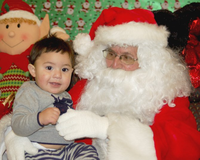 Santiago Mendoza visits with Santa Claus this past Friday at the Mid Valley Mall in Sunnyside. Santa will be at the mall every weekend until Christmas.