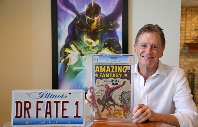 Steve Landman displays one of his collectable comic books, a vanity license plate with the name of a childhood superhero on it, and a poster of the same superhero Dr. Fate, at his home in Kildeer, Ill. Diagnosed with Anti-MAG IgM Peripheral Neuropathy, a rare autoimmune disease that attacks the nervous system, Landman has for months watched helplessly as the numbness that started in his toes crawls up his legs to the point where he now moves as if trudging in snow. As he tries to sell his dental practice years before he thought he would, he's jumped back into his collection of 10,000 comics selling 420 of them in an online auction that could bring in over $750,000 for his family and more importantly, bringing awareness and recognition to the disease that is robbing him of his mobility, and profession.