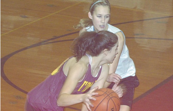 THE DALLES WAHTONKA senior Emily Bailey (front) tries to scoot past the tight defense played by Katie Conklin in Friday's inter-squad practice scrimmage at Kurtz Gym in The Dalles. Bailey and Conklin provide the Tribe with some scoring punch and some speed to hit the baseline for baskets.