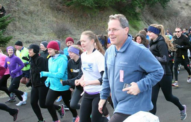 LOCAL HARRIERS hit the pavement for the Twin Tunnels Turkey Trot this past Thursday in Hood River. More than 300 signed up for running action in an effort to raise funds for Mosier Schools.
