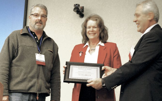 Columbia Basin Development League Trustee Clark Kagele, left, and Chairman Milt Johnston present Rep. Judy Warnick with an honorary life membership in November for her efforts to bring irrigation to farmland.