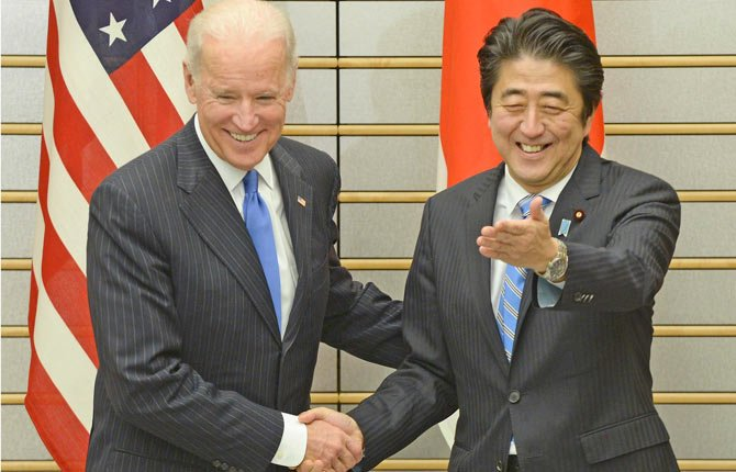 U.S. Vice President Joe Biden, left, is welcomed by Japanese Prime Minister Shinzo Abe prior to their talks at Abe's official residence in Tokyo Tuesday, Dec. 3. Biden, who is on the first leg of his three-nation Asian tour, met Abe, whose government is pressing the U.S. to more actively take Japan's side in an escalating dispute over China's new air defense zone above a set of contested islands in the East China Sea.