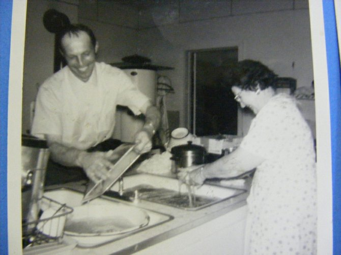 JERRY ROUTSON and his mother, Alyuna, prepare a meal in the kitchen in 1964.