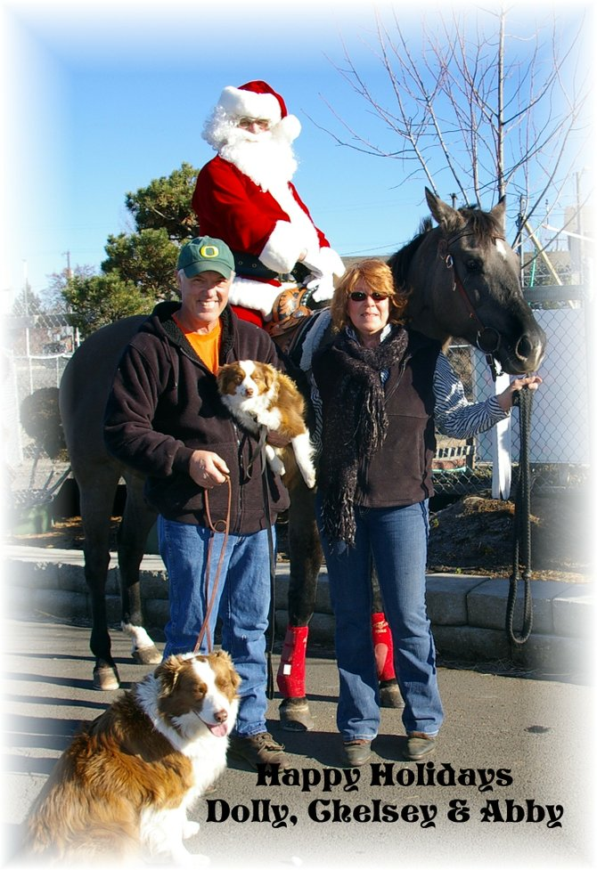 Dolly the horse welcomed Santa (Bob Haning) aboard Saturday, Nov. 23, in front of Green Acres Nursery in Grangeville. Owners Christie Brown and Dave Dixon are also shown here with dogs Chelsey and Abby.