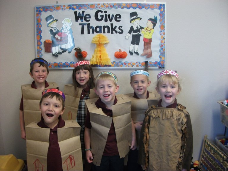 The kindergarten students at Summit were dressed for the Thanksgiving feast with the preschoolers on Monday, Nov. 25. The food was great and they had a good time remembering the first Thanksgiving! This is an example of what went on in many schools in the three days before Thanksgiving.