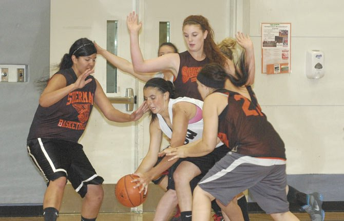 Sherman defenders (from left to right), Janet Guzman and Katie Poirier converge on The Dalles Wahtonka's Lori Cimmiyotti (middle) in summer hoops action. With some size and speed, Sherman has high expectations.