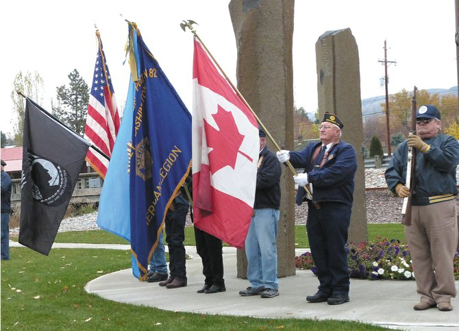 Veterans stand at attention during the Veterans Day ceremony Nov. 11 in Tonasket. A rifle corps offered a 21-gun salute.