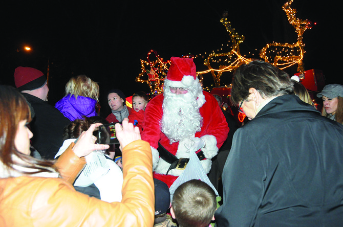 """Many entities came together to make the sixth annual Winter Magic tree lighting at Pioneer (city) Park a success Saturday, Nov. 30. Following Mayor Bruce Walker counting down to the lighting, several guests sang, anchored by a sing-a-long of """"Santa Claus is Coming to Town,"""" which was the call for Santa (seen here) to ride in on the antique Grangeville Volunteer Fire Department lighted fire truck."""