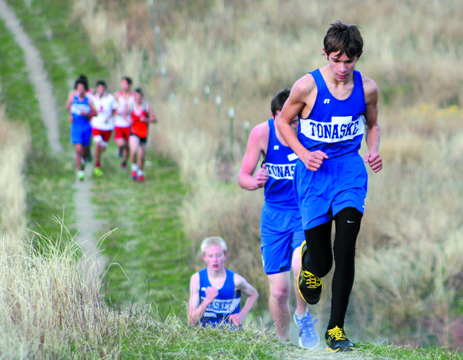 Tonasket cross country runners head up a hill during Tonasket meet Oct. 11. They included Hunter Swanson, Tim Jackson and Bryden Hires.