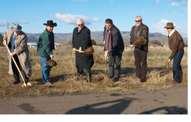 """THE DALLES and Klickitat County officials gathered at the Columbia Gorge Regional Airport Tuesday to break ground on 17 lots on 35 acres at a cost of $1.2 million in a new business park. Klickitat County is taking the lead on managing development of the park.  """"Government does not create jobs, that's the purview of the private sector. But what government can do is create infrastructure and we see this  project as the foundation for economic development,"""" said Klickitat County Commission Chair David Sauter. Some of the lots will be near the tarmac to serve aviation-related companies and the project is expected to provide 245 family-wage jobs. Pictured are, left to right, Allen Brecke of the Washington State Community Economic Revialization Board; Jim Sizemore, Klickitat County Commissioner; The Dalles Mayor Stephen Lawrence; Sauter; Klickitat County Commissioner Rex Johnston and airport board president Jim Wilcox. A larger story on economic development efforts at the airport is planned for Sunday, Dec. 8.Mark B. Gibson photo"""