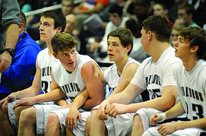 "Grangeville's bench, as seen during the final moments of last year's 2A title game, included guards Josh Dame and Quaid Blankenship — both of whom return as seniors this season — and Austin Parks, who worked his way onto the varsity squad as a freshman. While Grangeville will miss the post presence provided by 2013 graduates such as Brad Schumacher, a group of athletic shooters will give ""Coach of the Year"" Skip Hall's team a chance to return to the tournament the Bulldogs dominated one year ago. Pictured are (from left): Dame, Parks, Schumacher and Blankenship."