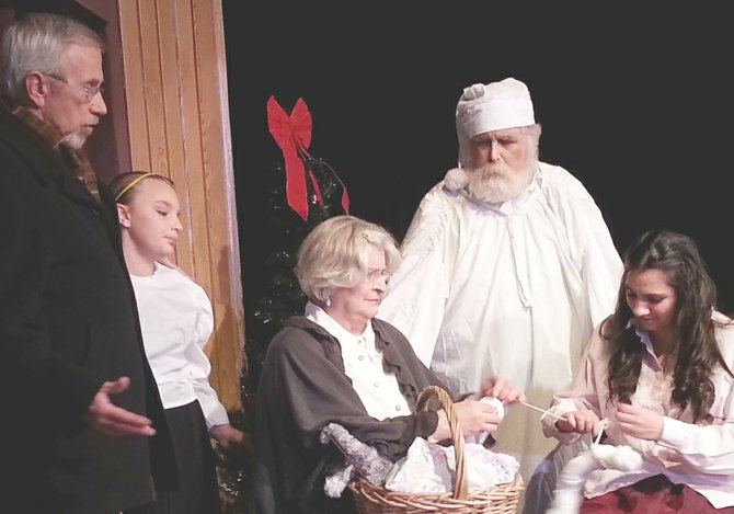 "Ebenezer Scrooge sees a glimpse of his past love, Belle, and her family in Valley Theater Company's production of ""A Christmas Carol,"" which opens a four-performance run tonight (Friday) at the Princess Theatre in Prosser. Pictured (L-R) are Darrel Fortune, Emalyn Smith, Colleen Schilperoort, Fred Bray and Emmalynn Pittenridge. Additional performances are Dec. 7, 13 and 14, all at 7:30 p.m. Tickets are available at the door."