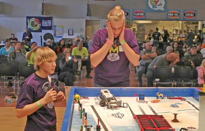 CONTESTANTS REACH a tense moment in playing field competition in the First Lego League tournament of 2012. Contributed photo