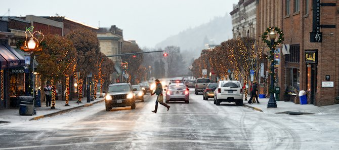 FIRST SNOW of the season fell in downtown Hood River and the Gorge Friday morning, to the delight of some, but to the dismay of others, like the many involved in morning traffic accidents.