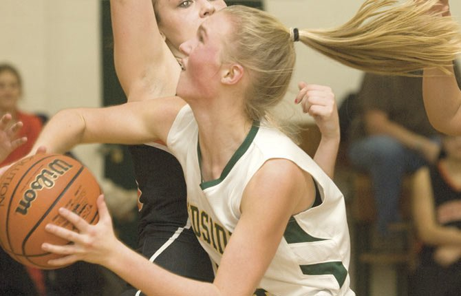 SOUTH WASCO'S Zoe Morelli elbows her way to the basket in a Big Sky Conference contest last season. Morelli brings her scoring skills to a Redside hoops team that scored 40.9 points a game in 2012.
