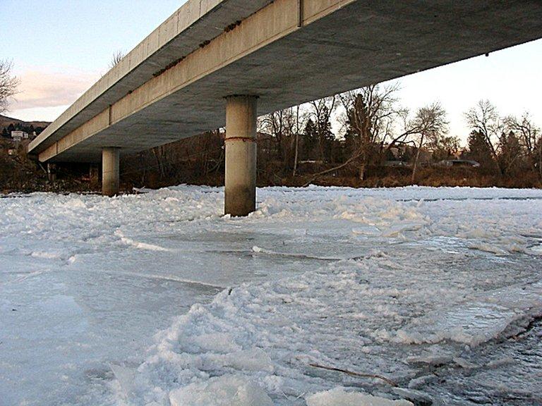 Ice coats the Okanogan River beneath a bridge in Okanogan following a week of frigid temperatures.