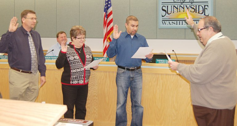 Councilman-elect Spencer Martin, Councilwoman Theresa Hancock and Councilman Francisco Guerrero (L-R) are sworn in by Judge Steven L. Michels at Monday night's Sunnyside City Council meeting. Michels himself was sworn in earlier in the meeting after the council approved his appointment for judicial services in the city of Sunnyside.